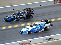 Jul 29, 2018; Sonoma, CA, USA; NHRA funny car driver John Force (near) races alongside Shawn Langdon during the Sonoma Nationals at Sonoma Raceway. Mandatory Credit: Mark J. Rebilas-USA TODAY Sports