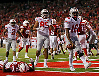 Ohio State Buckeyes quarterback J.T. Barrett (16) celebrates his touchdown after running over Nebraska Cornhuskers safety Joshua Kalu (46) at the goal line during the 2nd quarter at Memorial Stadium in Lincoln, Neb on October 14, 2017.  [Kyle Robertson/Dispatch]