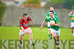 Fergus O'Connor (john Mitchels)  on the ball as he pushes away Jason McKenna (Glenbeigh/Glencar) .................................. ....