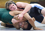 The Gazetter Eleanor Roosevelt's John Jones (top) has Parkdale's Andres Perdomo wrapped-up during their 145 pound bout. Jones won the match 4-2 in points. Roosevelt, Parkdale and Bowie faced each other in a tri-meet on Saturday afternoon at Bowie High School.