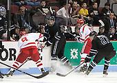 Brendan Collier (BU - 8), Tyler Deresky (Bentley - 11), Kevin Duane (BU - 18), Jared Rickord (Bentley - 27) - The visiting Bentley University Falcons defeated the Boston University Terriers 4-1 (EN) on Saturday, December 14, 2013, at Agganis Arena in Boston, Massachusetts.