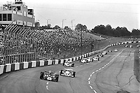 HAMPTON, GA - APRIL 22: Danny Ongais (#25 Parnelli VPJ6C/Cosworth TC) leads Tom Sneva (#1 McLaren M24/Cosworth TC) and others during the Gould Twin Dixie 125 event on April 22, 1979, at Atlanta International Raceway near Hampton, Georgia.