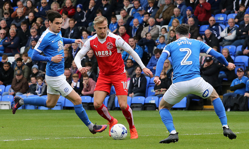Fleetwood Town's David Ball searches for an opening to get round Peterborough United's Michael Smith<br /> <br /> Photographer David Shipman/CameraSport<br /> <br /> The EFL Sky Bet League One - Peterborough United v Fleetwood Town - Friday 14th April 2016 - ABAX Stadium  - Peterborough<br /> <br /> World Copyright &copy; 2017 CameraSport. All rights reserved. 43 Linden Ave. Countesthorpe. Leicester. England. LE8 5PG - Tel: +44 (0) 116 277 4147 - admin@camerasport.com - www.camerasport.com