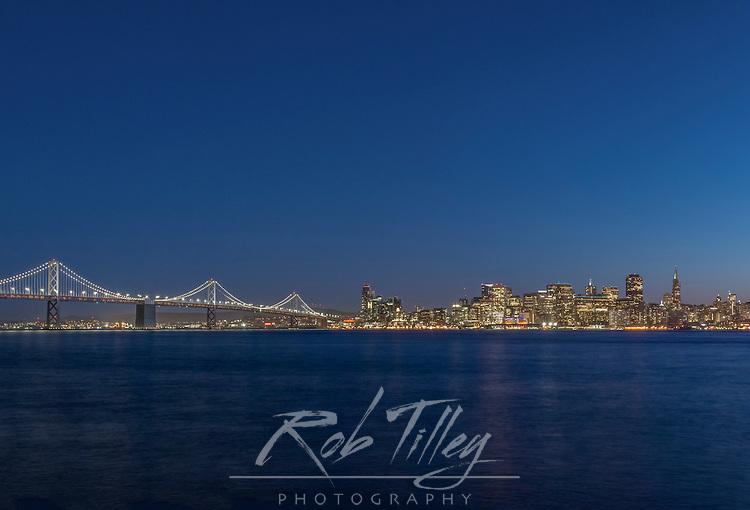 USA, CA, San Francisco, Bay Bridge & Downtown Skyline at Twilight