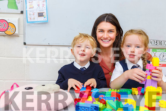 Liam Joy and Nessa Flynn is welcomed by Princupal Catherine Ní Mhuircheartaigh on their first day at school in Fybough NS on Tuesday