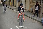 Kids play in a street near their house, where they live amongst an asylum-seeker community, in southern Tel Aviv, Israel.