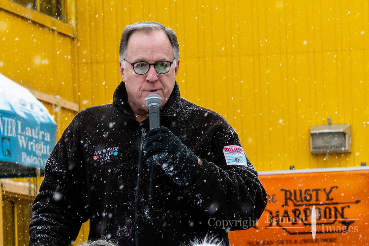ANnouncer starts off the race festivities at 4th Avenue and D street in downtown Anchorage, Alaska on Saturday March 7th during the 2020 Iditarod race. Photo copyright by Cathy Hart Photography.com
