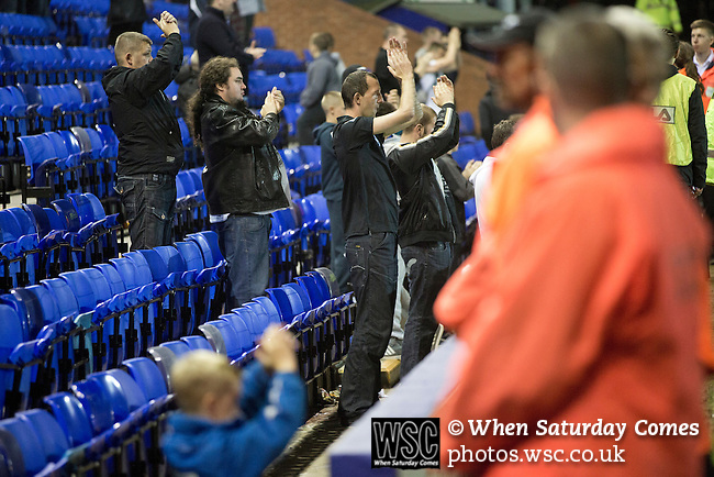 Tranmere Rovers 0 Stoke City 2, 25/09/2013. Prenton Park, Captial One Cup Third Round. Home team supporters in the Bebington Kop applauding their team off the pitch at Prenton Park as Tranmere Rovers lose to Stoke City in a Capital One Cup third round match. The Capital One cup was formerly known as the League Cup and was competed for by all 92 English Premier League and Football League clubs. Visitors Stoke City won the match 2-0, watched by a crowd of 5,559 spectators. Photo by Colin McPherson.