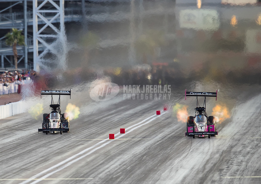 Oct 29, 2016; Las Vegas, NV, USA; NHRA top fuel driver Wayne Newby (left) races alongside Clay Millican during qualifying for the Toyota Nationals at The Strip at Las Vegas Motor Speedway. Mandatory Credit: Mark J. Rebilas-USA TODAY Sports
