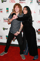 LOS ANGELES, CA, USA - OCTOBER 26: Steven Adler, Nancy Sayle arrive at An Evening Of Art With Billy Morrison And Joey Feldman Benefiting The Rock Against MS Foundation held at Village Studios on October 26, 2014 in Los Angeles, California. (Photo by David Acosta/Celebrity Monitor)