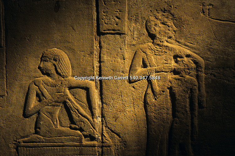 Detail of relief of wet nurses feeding child and crocodile,found in Ptolemaic temple of Amun at Hibis the Darb el-Arbaein, trade routeEgypt; Archaeologist; Salima Ikram; Kharga Oasis;Ancient Cultures; mm7195; Desert; Oasis