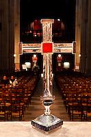 A l'église Sainte Clotilde de Paris, 7eme arrondissement, le 19 janvier 2011, Goudji remet la croix créée par ses soins au Père Matthieu Rougé, curé de la paroisse. Détail de la croix. In the Church Sainte Clotilde of Paris, in the 7th arrondissement, on January 19th, 2011, Goudji delivers the cross that he has created for the church to the priest Matthieu Rougé. Detail of the cross with the nave of the church in the background. Born in Georgia in 1941, Goudji has lived in Paris since 1974, due to the personal intervention of President Georges Pompidou. Here he produces his numerous contemporary works of goldsmithery in such widely differing fields as Church Art, swords, jewellery and sculpture. Picture by Manuel Cohen - Further clearance required, please contact us