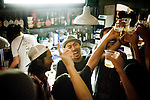 Tokyo, August 30 2012 - Dengaryu, hip hop singer and actor in the movie Saudade by Katsuya Tomita, having a beer with his friends after his concert in Shibuya.