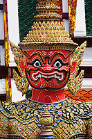 One of six pairs of guardian demons flanking entrance to the Gallery or Phra Rabiang, Wat Phra Kaeo, Bangkok, Thailand