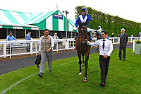 Winner of The Penang Turf Club Malaysia Novice Stakes Humanitarian ridden by Rober Havlin and trained by John Gosden is led into the Winners enclosure during Afternoon Racing at Salisbury Racecourse on 16th May 2019