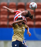 Cris Mabel Flores (PAR) gets to the ball ahead of Sam Johnson (USA)..FIFA U17 Women's World Cup, Paraguay v USA, Waikato Stadium, Hamilton, New Zealand, Sunday 2 November 2008. Photo: Renee McKay/PHOTOSPORT