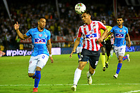 BARRANQUILLA - COLOMBIA, 27-03-2019: Teófilo Gutiérrez de Atlético Junior disputa el balón con Edison Restrepo de Unión Magdalena, durante partido adelantado de la fecha 13 entre Atlético Junior y Unión Magdalena, por la Liga Águila I 2019, jugado en el estadio Metropolitano Roberto Meléndez de la ciudad de Barranquilla. / Teofilo Gutierrez of Atletico Junior vies for the ball with Edison Restrepo of Union Magdalena, during match ahead of date 13th between Atletico Junior and Union Magdalena, for the Aguila Leguaje I 2019 at the Metropolitano Roberto Melendez Stadium in Barranquilla city, Photo: VizzorImage  / Alfonso Cervantes / Cont.