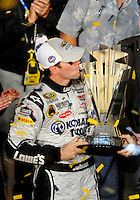 Nov. 16, 2008; Homestead, FL, USA; NASCAR Sprint Cup Series driver Jimmie Johnson kisses the trophy after winning the 2008 championship following the Ford 400 at Homestead Miami Speedway. Mandatory Credit: Mark J. Rebilas-