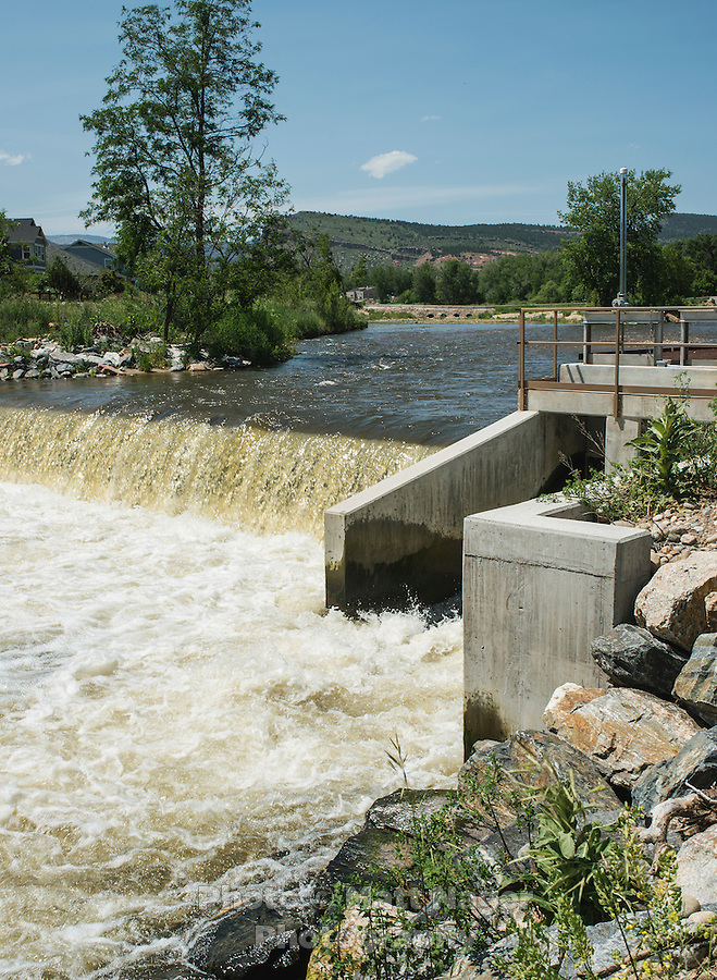 A new dam built after the 2013 flood in the St. Vrain River near Lyons, Colorado, Monday, June 23, 2015. The St. Vrain River flooded in 2013 after days of big rains. <br /> <br /> Photo by Matt Nager