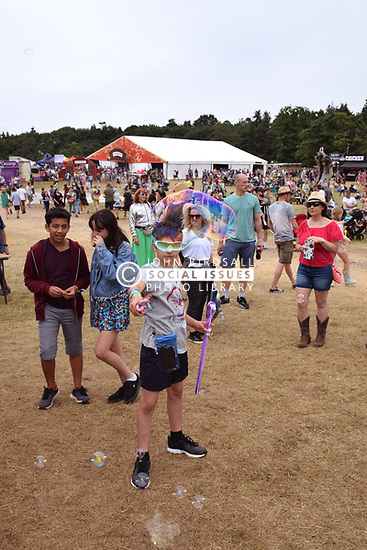 Latitude Festival 2017, Henham Park, Suffolk, UK. Children playing with bubbles