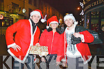 Taking part in the Santa Race in Cahersiveen on New Years Eve were l-r; In second place Shane Leavey(Kelly's Bar), Alanna Kelleher & in first place Fergus Keating.