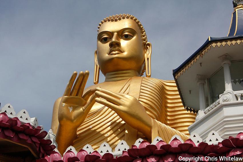 Seated Buddha statue (turning the wheel of Dharma pose), Golden Temple, Dambulla, Sri Lanka