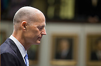 TALLAHASSEE, FLA. 3/5/13-OPENING030513CH- Gov. Rick Scott joins the Senate in prayer during the opening day of the 2013 legislative session Tuesday at the Capitol in Tallahassee, Fla...COLIN HACKLEY PHOTO
