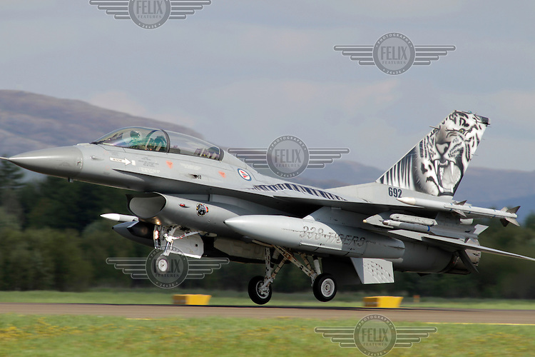 Norwegian F-16 in tiger paint scheme. Nato Tiger Meet is an annual gathering of squadrons using the tiger as their mascot. While originally mostly a social event it is now a full military exercise. Tiger Meet 2012 was held at the Norwegian air base Ørlandet.