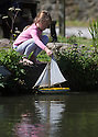 29/08/16<br /> <br /> A young girl, enjoying the Bank Holiday sunshine, launches her model yacht into Cromford Canal near Matlock, Derbyshire.<br /> <br /> All Rights Reserved, F Stop Press Ltd. +44 (0)1773 550665