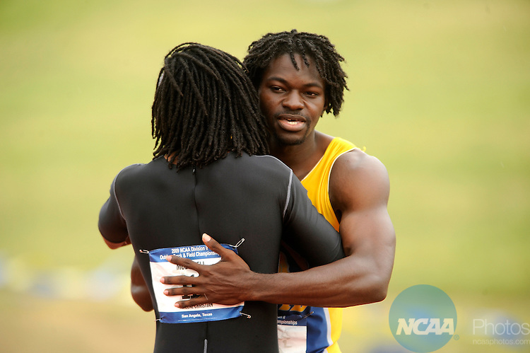 23 MAY 2009: Albany State's Ronnie McGirt (right) gets a hug from Abilene Christian University's Andrew McDowell after the finish of the men's 110m hurdles during the Division II Men's and Women's Track and Field Championship held at the LeGrand Sports Complex at Angelo State University in San Angelo, TX.  McGirt won the race with a time of 13.69, McDowell finished second. Tommy Metthe/NCAA Photos