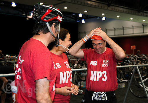 10 AUG 2014 - LIVERPOOL, GBR - Shadow Secretary of State for Health Andy Burnham (right) jokes with the other members of Team Liverpool MPs, former Liverpool mayor Steve Rotherham (left), Shadow Minister for Public Health, Luciana Berger (centre) before the Tri Liverpool triathlon relay in Kings Dock in Liverpool, Great Britain. Burnham finished the swim leg in 20:50, Rotherham completed the bike in 48:26 with Berger giving the team a finish time of 1:51:12 with a 35:45 run (PHOTO COPYRIGHT © 2014 NIGEL FARROW, ALL RIGHTS RESERVED)