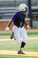 Josh Greene (1) of the High Point Panthers hustles down the first base line against the Wake Forest Demon Deacons at Wake Forest Baseball Park on April 2, 2014 in Winston-Salem, North Carolina.  The Demon Deacons defeated the Panthers 10-6.  (Brian Westerholt/Four Seam Images)