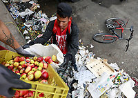 BOGOTA, COLOMBIA - April 17: People of Low income search for leftovers of rotten fruits and vegetables in a trash dumpster in Corabastos, the main food distribution center of the country, on April 17, 2020 in Bogota, Colombia. Alimentary aid offered by the National government has not reached yet the poorest families, amid the coronavirus crisis. (Photo by John W. Vizcaino/VIEWpress)