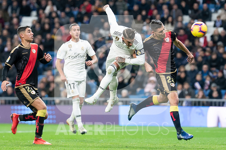 Sergio Ramos of Real Madrid and Emiliano Velazquez of Rayo Vallecano during La Liga match between Real Madrid and Rayo Vallecano at Santiago Bernabeu Stadium in Madrid, Spain. December 15, 2018. (ALTERPHOTOS/Borja B.Hojas)