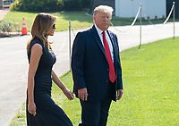 United States President Donald J. Trump and First lady Melania Trump depart the White House, August 7, 2019 to visit El Paso, TX and Dayton Ohio after recent shootings in those cities. <br /> CAP/MPI/RS<br /> ©RS/MPI/Capital Pictures