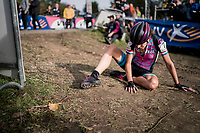 after crossing the finish line Helen Wyman (GBR/Kona) dropped to the ground, completely exhausted, trying to catch her breath again<br /> <br /> Women's race<br /> Koppenbergcross / Belgium 2017