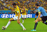 RIO DE JANEIRO - BRASIL -28-06-2014. Teofilo Gutierrez (#9) jugador de Colombia (COL) disputa un balón con Diego Godin (#3) jugador de Uruguay (URU) durante partido de los octavos de final por la Copa Mundial de la FIFA Brasil 2014 jugado en el estadio Maracaná de Río de Janeiro./ Teofilo Gutierrez (#9) player of Colombia (COL) fights the ball with Diego Godin (#3) player of Uruguay (URU) during the match of the Round of 16 for the 2014 FIFA World Cup Brazil played at Maracana stadium in Rio do Janeiro. Photo: VizzorImage / Alfredo Gutiérrez / Contribuidor