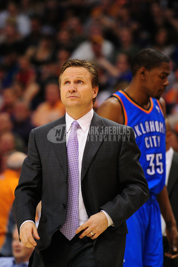 Mar. 30, 2011; Phoenix, AZ, USA; Oklahoma City Thunder head coach Scott Brooks against the Phoenix Suns at the US Airways Center. Mandatory Credit: Mark J. Rebilas-