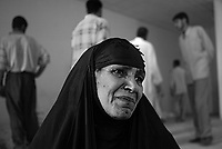 Moussayib, Iraq, May 24, 2003.More than 400 bodies found in a mass grave in Djur Al Saher have been brought to a theater hall in Moussayib to allow identification by the families. .Mehedieh Rashideh asks the dead to help her to find the body of her son Haider Abud Shawa missing since 1991.