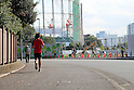 A man runs past the site for the new National Stadium and centrepiece for the Tokyo 2020 Olympic Games on October 18, 2016, Tokyo, Japan. The new stadium designed by Kengo Kuma is projected to cost $1.47 billion and construction has been delayed by design changes and attempts to prevent the budget for the Games spiraling out of hand. The Japanese government finally approved the a budget of $1.5 billion for the project at the end of September and construction is now expected to take three years concluding in November 2019. (Photo by Rodrigo Reyes Marin/AFLO)