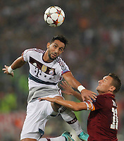 Bayer's Mehdi Benatia challanges  Roma's Francesco Totti  during the Champions League Group E soccer match between As Roma and FC Bayern Munchen at the Olympic Stadium in Rome october 21 , 2014.