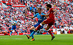 Liverpool's Mohamed Salah (R) shoots at goal past Arsenal's Rob Holding during the premier league match at Anfield Stadium, Liverpool. Picture date 27th August 2017. Picture credit should read: Paul Thomas/Sportimage