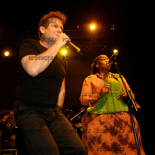 Johnny Clegg - performing live with Mandisa Dlanga at the Forum in London UK -  28 August 2008.  Photo credit: George Chin/IconicPix