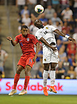 Reggie Cannon (14) of the United States and Abdiel Arroyo (18) of Panama vie for a header during their Gold Cup match on June 26, 2019 at Children's Mercy Park in Kansas City, KS.<br /> Tim VIZER/AFP