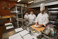 Chef Noah Miller instructs Culinary Arts students Jannie Mangalus and Shelby Boos during Miller's A la Carte Kitchen and Culinary Skill Development laboratories in Lucy Cuddy Hall's Bakery.