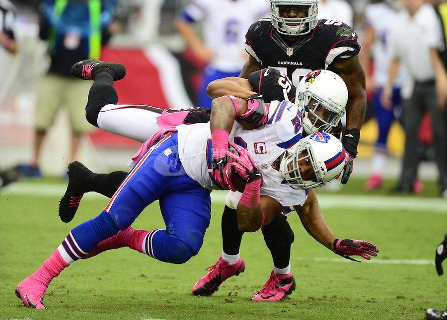 Oct. 14, 2012; Glendale, AZ, USA; Buffalo Bills running back (22) Fred Jackson is tackled by Arizona Cardinals safety (25) Kerry Rhodes in the first half at University of Phoenix Stadium. The Bills defeated the Cardinals 19-16 in overtime. Mandatory Credit: Mark J. Rebilas-