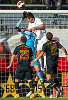 COLLEGE PARK, MD - NOVEMBER 03: Jackson Ragen #25 of Michigan goes up with Niklas Neumann #36 of Maryland for  cross during a game between Michigan and Maryland at Ludwig Field on November 03, 2019 in College Park, Maryland.
