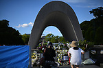 HIROSHIMA, JAPAN - AUGUST 05: Visitors lays flowers and pray for the atomic bomb victims in front of the cenotaph at the Hiroshima Peace Memorial Park in Hiroshima, western Japan on August 5, 2019, a day before the 74th anniversary ceremony of the attack. (Photo: Richard Atrero de Guzman/ AFLO)