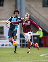 Sido Jombati of Wycombe Wanderers and Nicky Adams of Northampton Town during the Sky Bet League 2 match between Northampton Town and Wycombe Wanderers at Sixfields Stadium, Northampton, England on the 20th February 2016. Photo by Liam McAvoy.