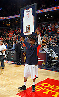 Virginia guard Jontel Evans (1) holds up his jersey for senior night during the game against Maryland Sunday in Charlottesville, VA. Photo/Andrew Shurtleff